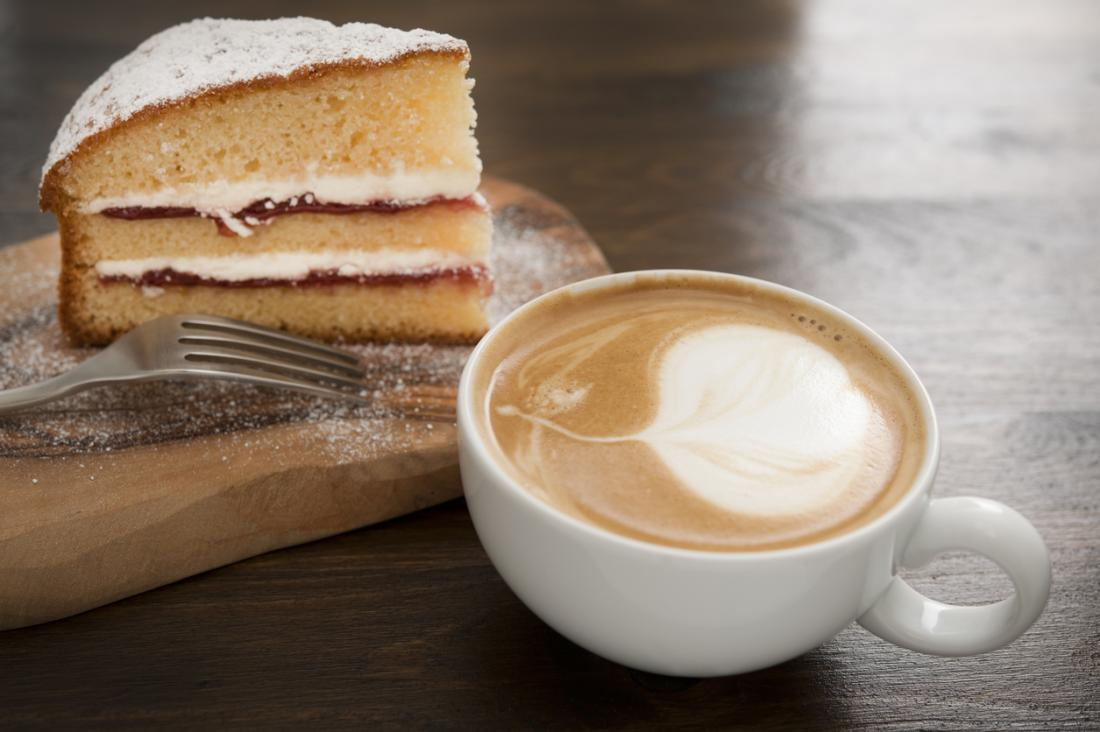 a cup of coffee and a slice of cake